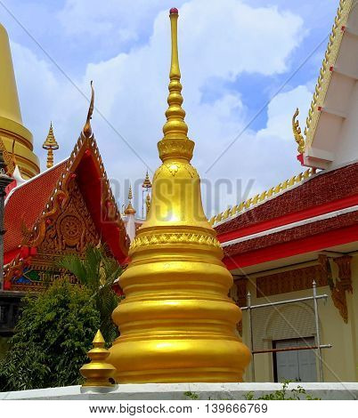 small, golden chedi relic tower at a Buddhist temple, Songkhla, Thailand