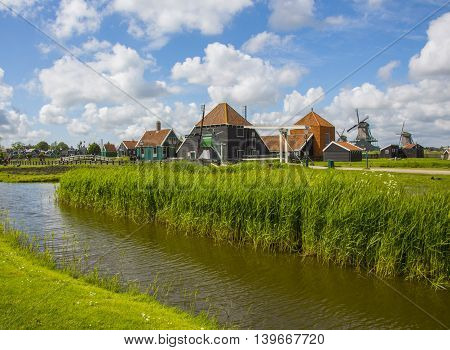 Netherlands Holland rural landscape with windmill clouds summer