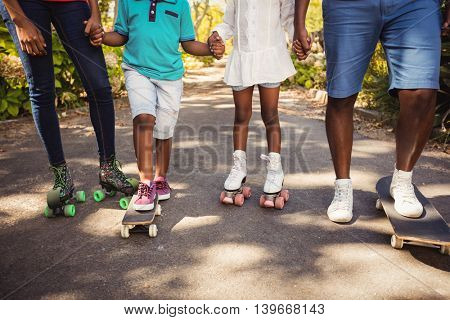 Focus on legs of family at park