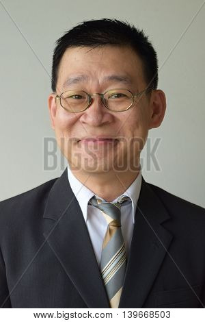 Mature Man in business suit smiling awkwardly