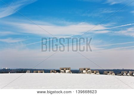 Beautiful Landscape With Water Tower And Housing Area In Winter And Blue Sky