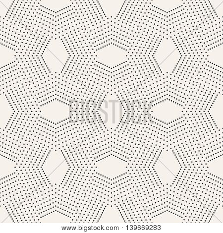 Seamless pattern. Modern stylish texture with dots. Infinitely repeating small textured geometrical tiles consisting of dotted rhombuses diamonds.