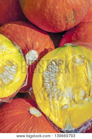 Fresh Pumpkin Cut Half And Half On The Fruit Market