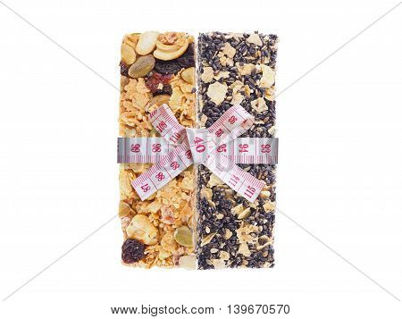 Healthy granola and measure tape bow tied isolated on white background. Diet and healthy concept.