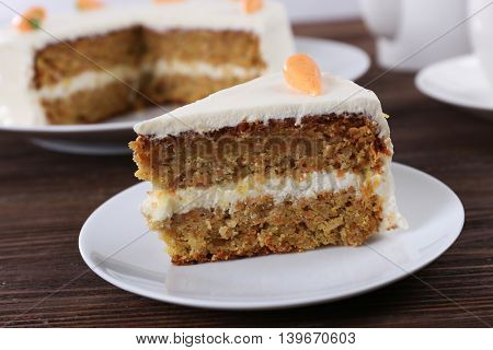 Delicious carrot cake on wooden table