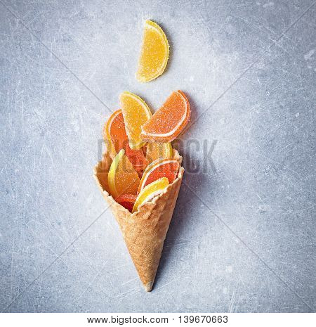 Dessert in ice cream cone on gray background