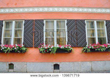 Beautiful windows and flowerpots on an old building in Helsinki Finland.