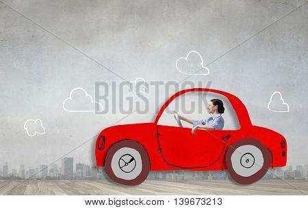 Woman driving old styled drawn car  . Mixed media