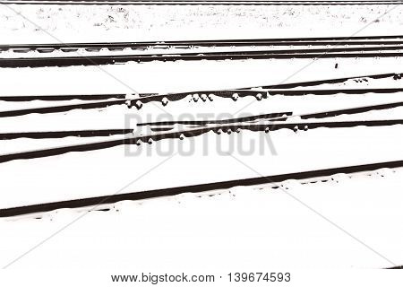 Railroad tracks in Winter with snow in detail