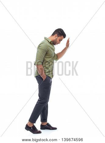 Casual man stress upset hand on wall looking down, businessman depression pondering young handsome guy full length wear shirt isolated white background