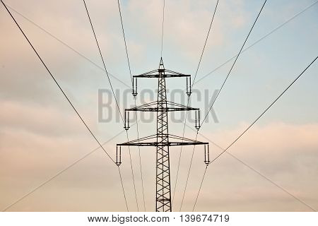 Acres With Snow In Winter Iand Electrical Tower In Beautiful Light
