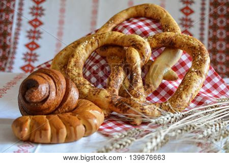 Homemade bread: pretzel bun Snail with poppy seeds and a croissant with jam