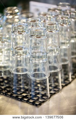 Close-up of stacked glass at bar