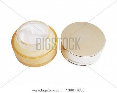 Top view of opened cream container with cap isolated on white background