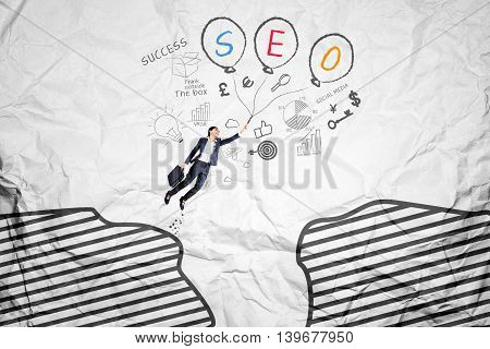 Female worker flying through a cliff with SEO word on the balloons shot with crumpled background