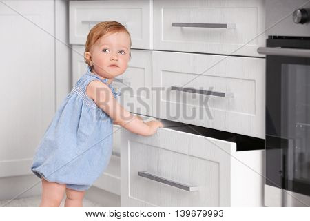 Child playing with cupboard