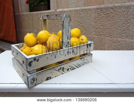 Citrus fruits in white painted wood box on market day in Mallorca Balearic islands Spain.