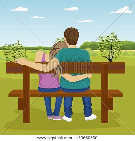 Rear view of happy young couple sitting together on bench outdoors in summer