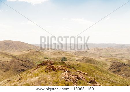 The parched rocky hills and sky summer day.