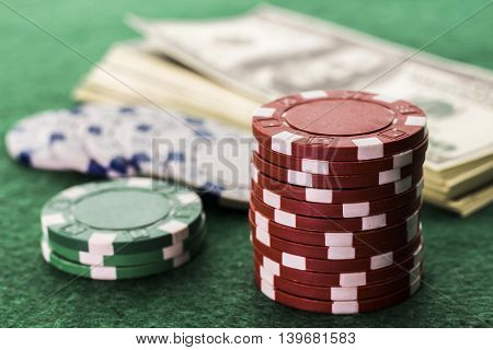 Poker game with a lot of dollars on the table