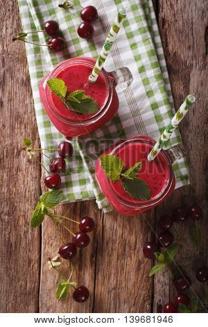 Healthy Cherry Cocktail With Mint In Glass Jars Close-up. Vertical Top View