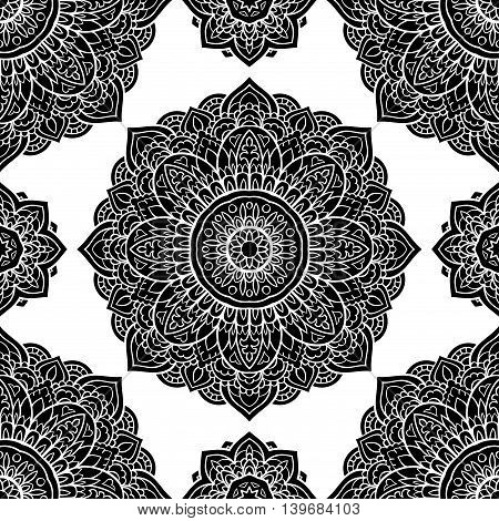 Seamless graphic pattern of mandalas on a white background. Vector elegance ornament. Black stencil for any surface.