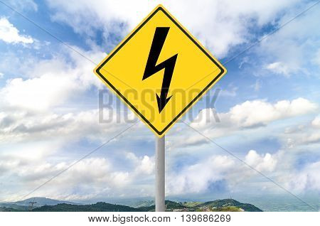High voltage sign on traffic sign with blue sky