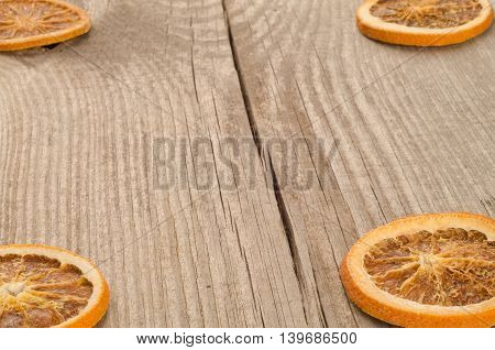 dried slices of orange on wooden background