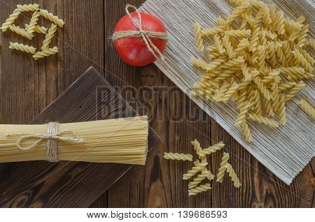 Spaghetti pasta with tomatoes on a wood table top