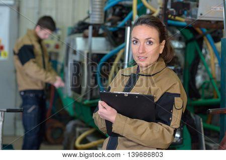 female mechanic in factory