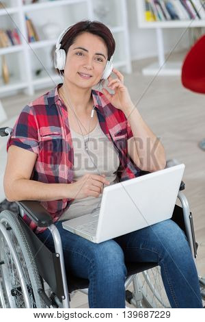 woman in wheelchair using computer