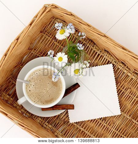 Flat lay background breakfast with a bouquet of wild flowers the Andes a frothy coffee top view / Coffee with the scent of flowers