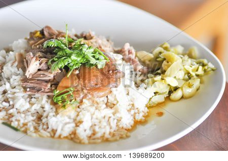 Stewed pork leg on rice dish on the table