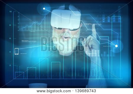 Aged bearded man in virtual reality headset is standing in front of interactive screen with diagram and looks like having a good idea