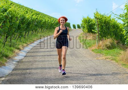 Fit Attractive Woman Running In The Country