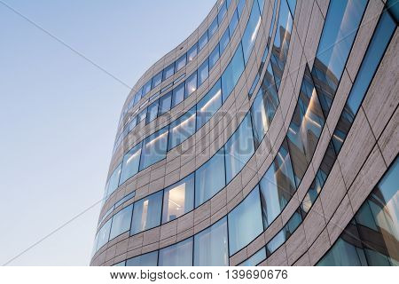 Modern Curving Window Glass Tile Architecture in Düsseldorf with Blue Sky