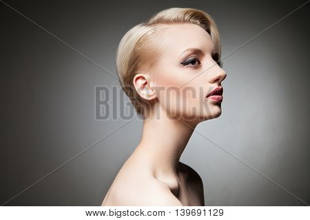 Sensual model with make-up and stylish haircut looking away.Studio shot.Isolate