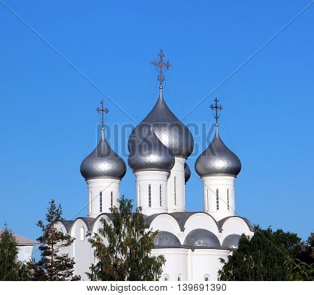 Sophia cathedral in the Vologda city, Russia. Summer sunny day. White church. Top part of the building