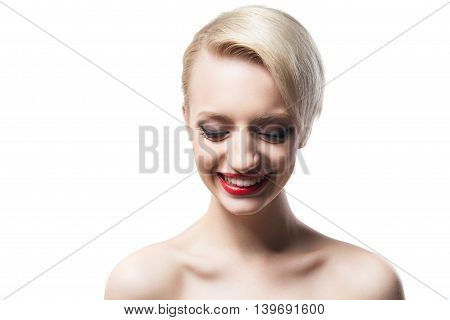 Portrait of pretty young girl with red lips and blonde short hair looking down with toothy smile.Isolate