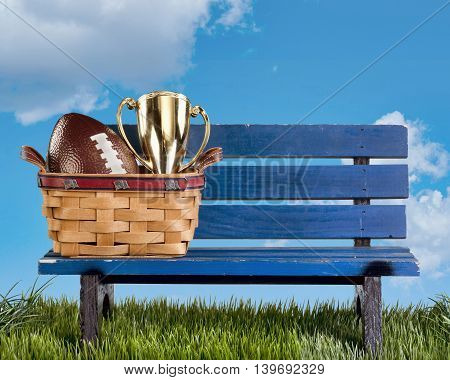 Blue park bench with handmade basket and football..