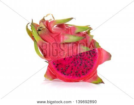 Fresh red dragon fruit cut pieces on white background.
