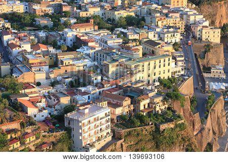 Beautiful city landscape in style of traditional Italian architecture at sunset. Amalfi Coast, Italy.