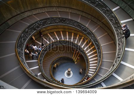 ROME, ITALY - March 02, 2016 : Top view of famous stairs with round shape at Vatican Museum.
