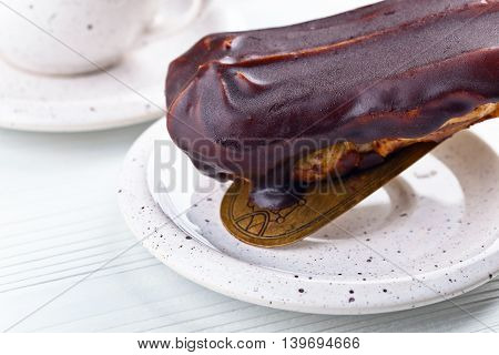 French Eclair On Wooden Table