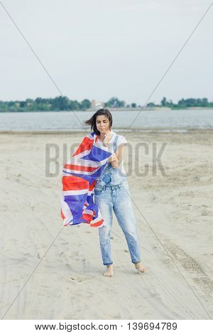 portrait girl the beach dawn she denim overalls white t-shirt British moisture