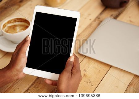 Close Up Of Dark-skinned Woman's Hands Holding Generic Blank Screen Touchpad With Copy Space For You