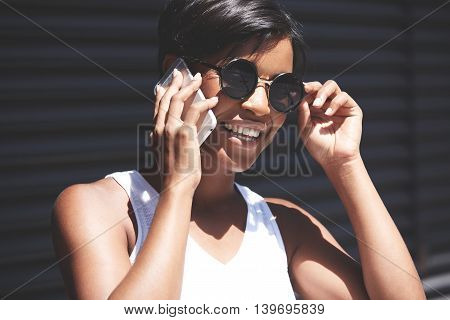 Pretty African Office Worker Chilling In The Shadow Wearing Sunglasses During Coffee Break. Black Fe
