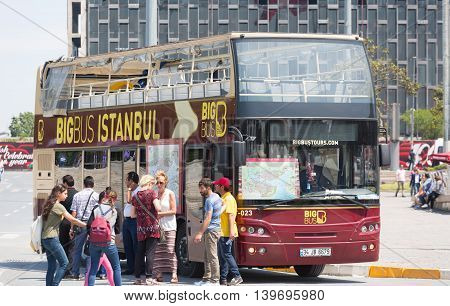 TURKEY, ISTANBUL-MAY 15 2015: Tourists near the double-decker tour bus in the center of Istanbul