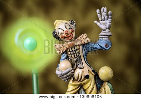 ball juggling happy clown with spinning pinwheel