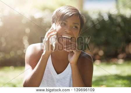 Close Up Portrait Of Beautiful Dark Skinned Woman With Short Hairstyle, Talking On Cell Phone, Smili